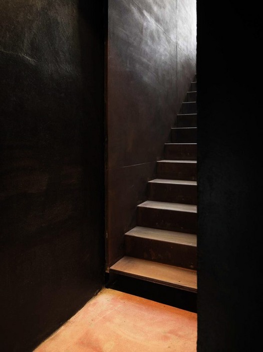 The stair in corten going to the underground floor