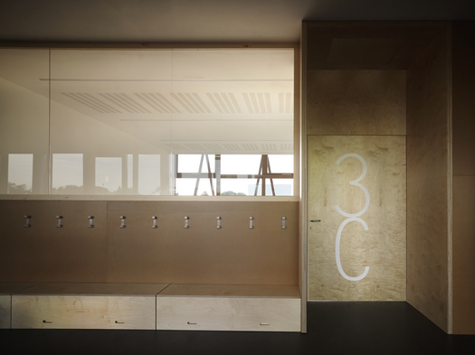 The wood and glass-made classrooms' walls